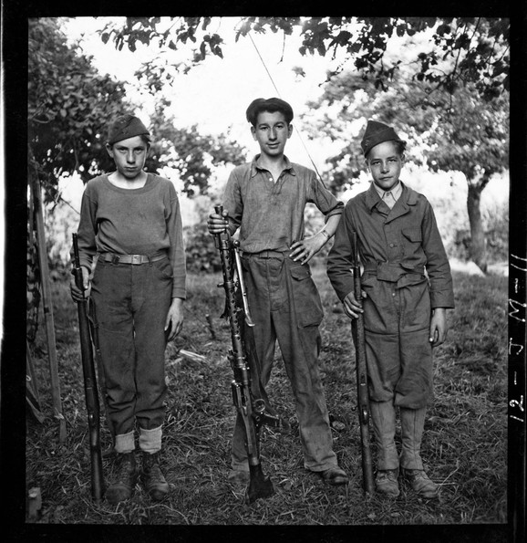 From left to right: Claude Anquetil, 16, Tino Boggini, 17 and Auguste Sabine, 17, orderlies at the First United States Army press camp, ouilly, Calvados, Normandy, August 6, © John G. Morris